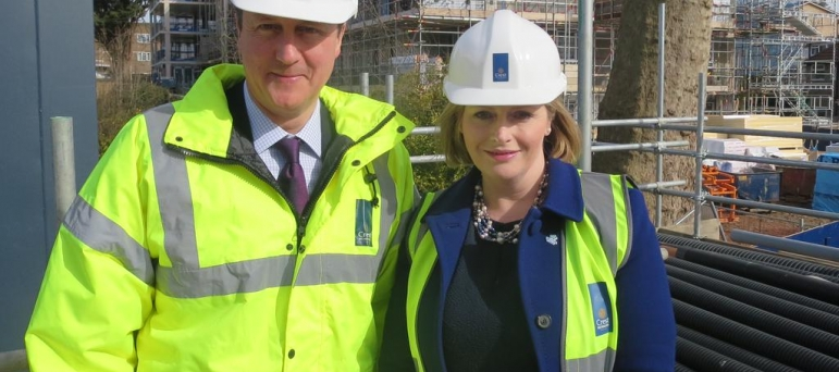 Mary with David Cameron at housing development